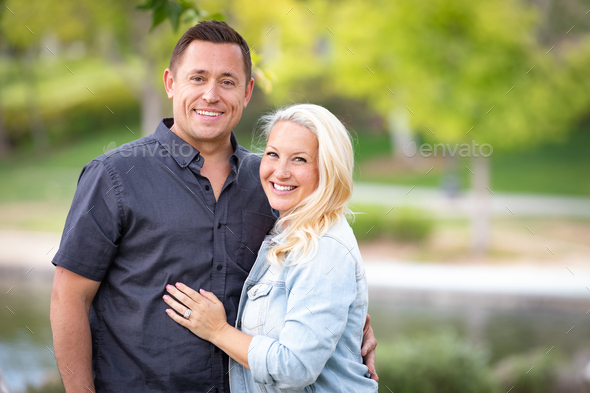 Young Caucasian Couple Portrait In The Park - Stock Photo - Images
