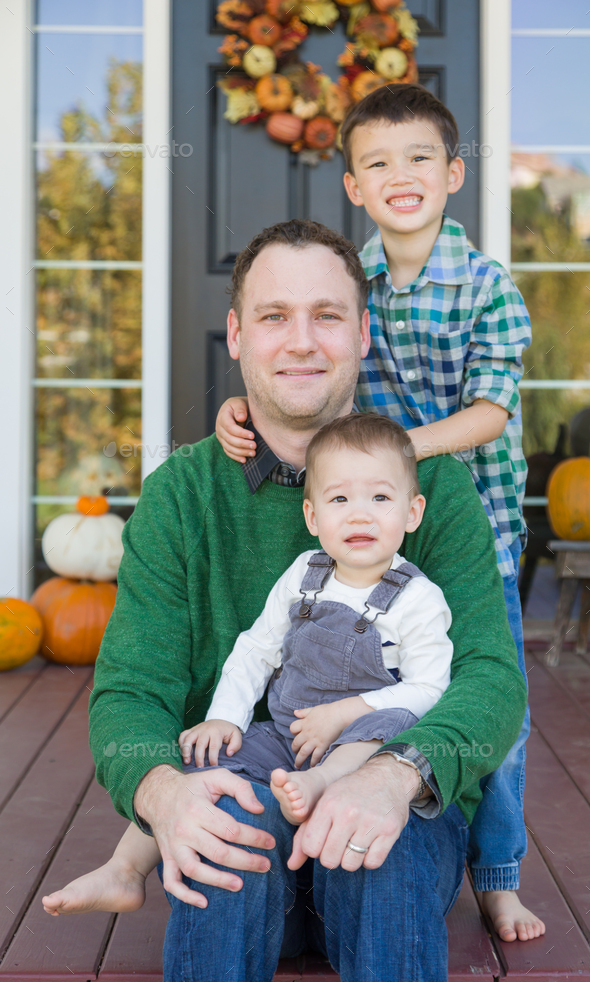 Young Mixed Race Chinese and Caucasian Father with His Sons - Stock Photo - Images