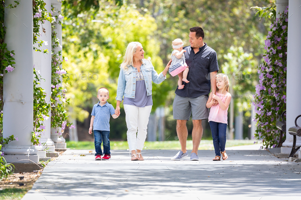 Young Caucasian Family Taking A Walk In The Park - Stock Photo - Images