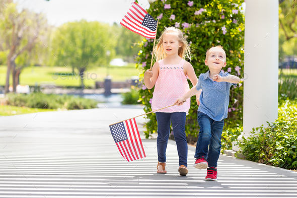 Young Sister and Brother Waving American Flags At The Park - Stock Photo - Images