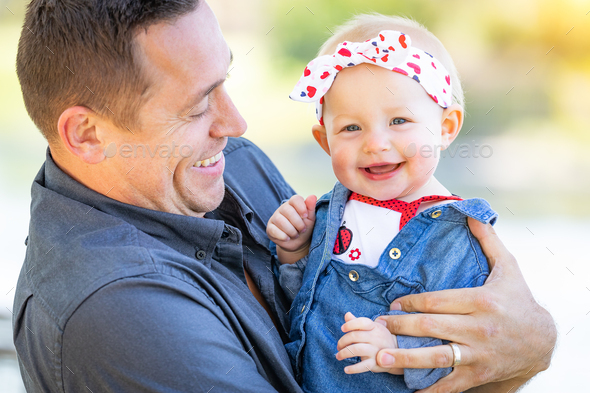 Young Caucasian Father and Baby Girl At The Park - Stock Photo - Images