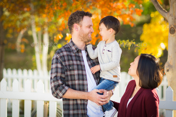 Outdoor Portrait of Mixed Race Chinese and Caucasian Parents and Child. - Stock Photo - Images