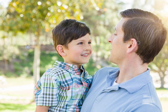Happy Caucasian Father and Son Playing Together in the Park. - Stock Photo - Images