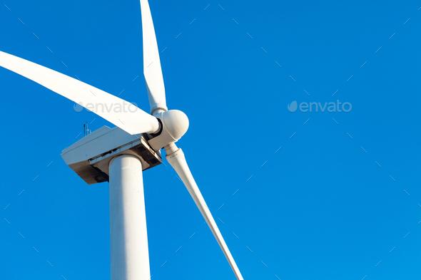 Single Wind Turbine Over Dramatic Blue Sky - Stock Photo - Images