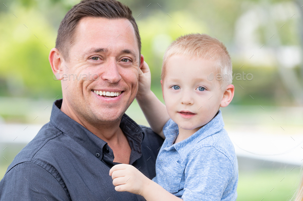 Young Caucasian Father and Son Having Fun At The Park - Stock Photo - Images