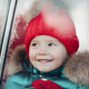Smiling cute winter girl in red hat sitting in car having fun - PhotoDune Item for Sale