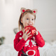 Lovely little girl in red dress with Christmas present - PhotoDune Item for Sale