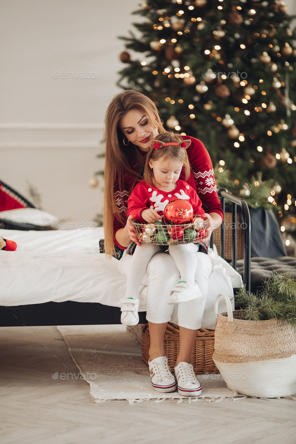 Beautiful mother giving her daughter a present - Stock Photo - Images