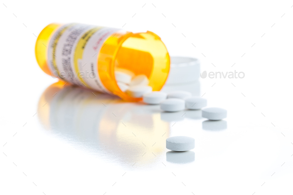 Non-Proprietary Medicine Prescription Bottle and Spilled Pills Isolated on White - Stock Photo - Images