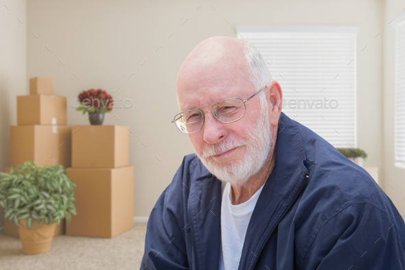 Senior Man in Empty Room with Packed Moving Boxes - Stock Photo - Images