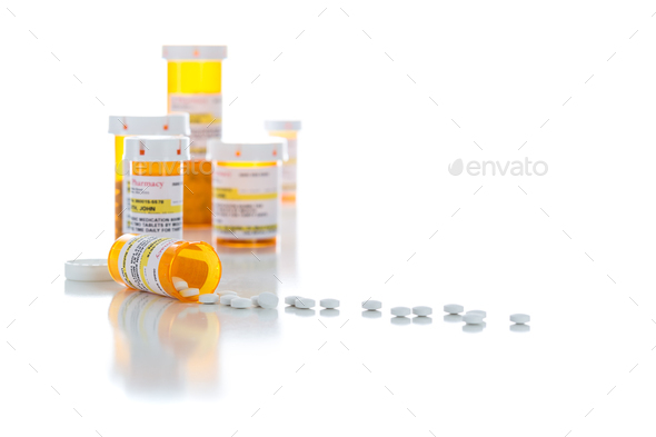 Non-Proprietary Medicine Prescription Bottles and Spilled Pills Isolated on White - Stock Photo - Images