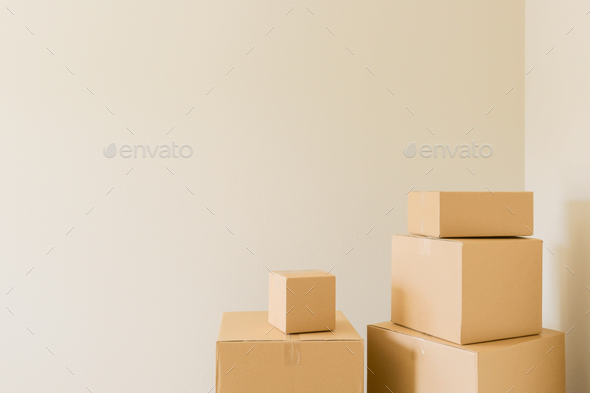 Packed Moving Boxes In Empty Room - Stock Photo - Images