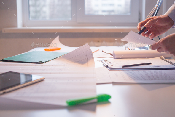 Architect alone at his working place. Paperwork - Stock Photo - Images