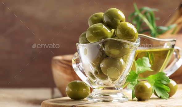 Green greek olives in glass bowl - Stock Photo - Images