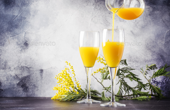 cocktail mimosa with orange juice - Stock Photo - Images