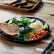 Healthy breakfast or lunch at home or cafe with fried egg, avocado, toasts, beans and fresh spinach - PhotoDune Item for Sale