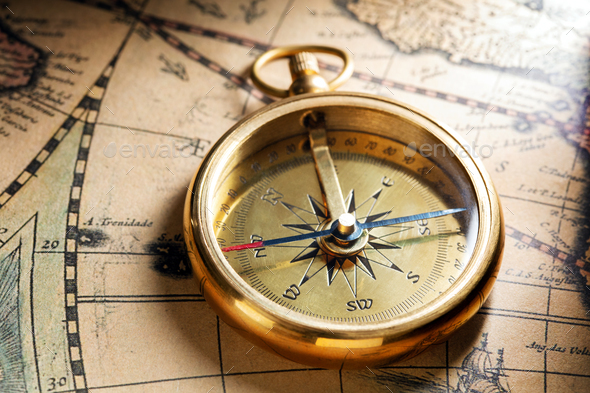 Antique compass on ancient map - Stock Photo - Images