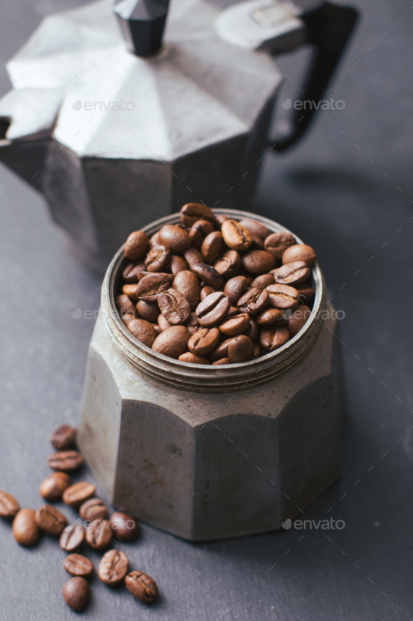 Coffee beans in vintage coffee jug - Stock Photo - Images