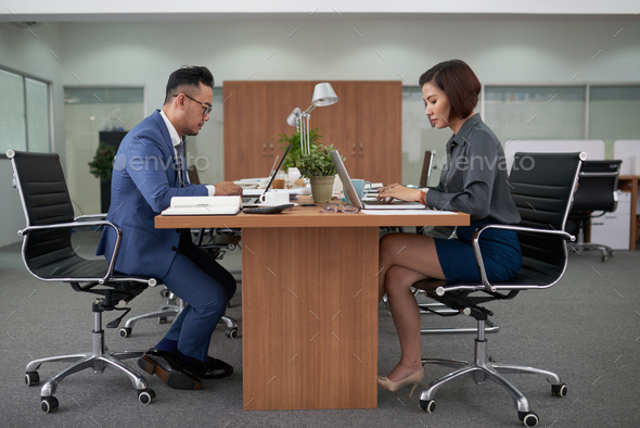 Asian Colleagues Focused on Work - Stock Photo - Images