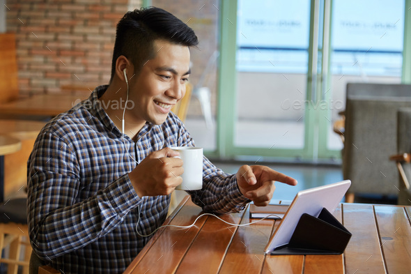 Man at coffee shop - Stock Photo - Images