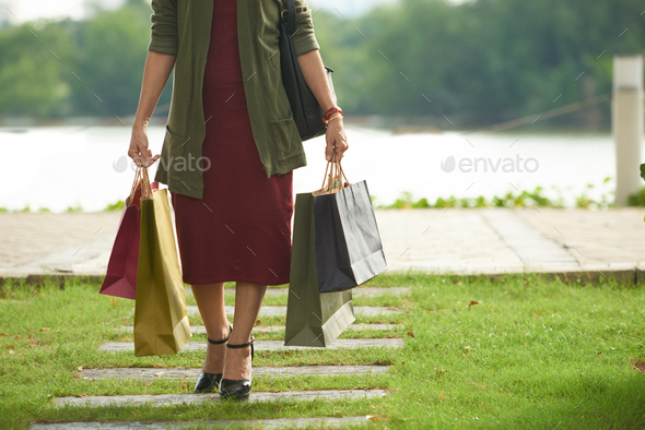 Woman with paper bags - Stock Photo - Images