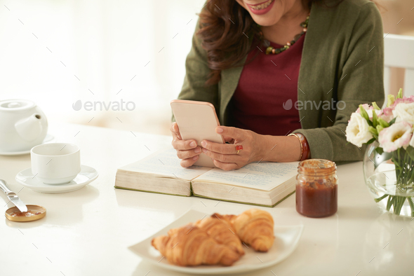 Woman typing a message - Stock Photo - Images