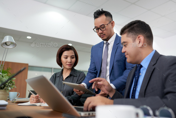 Analyzing Statistic Data with Coworkers - Stock Photo - Images