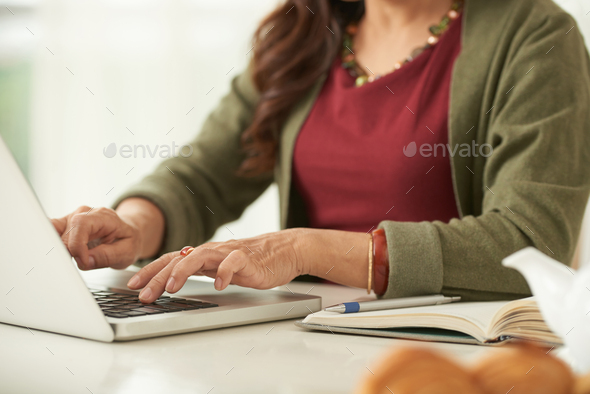 Typing on laptop - Stock Photo - Images