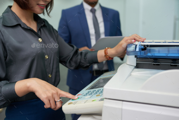 Office Assistant Using MF Printer - Stock Photo - Images