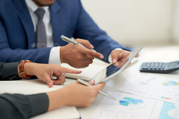 Financial Managers Wrapped up in Work - Stock Photo - Images