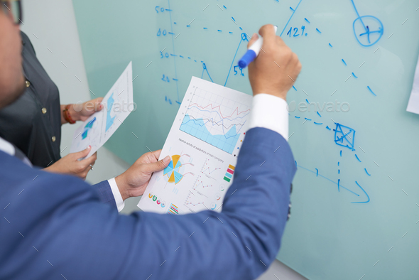 Managers Drawing Business Graph - Stock Photo - Images