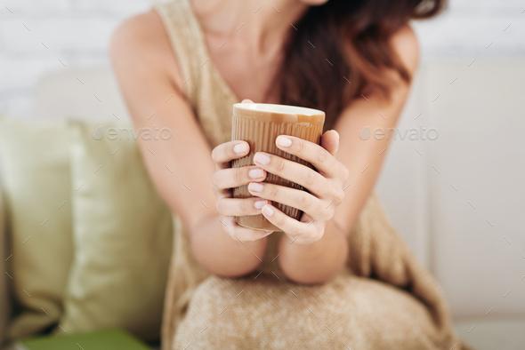 Brown ceramic mug in girls hands - Stock Photo - Images