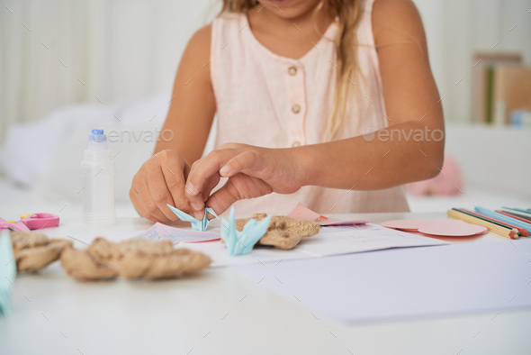 Making origami cranes - Stock Photo - Images