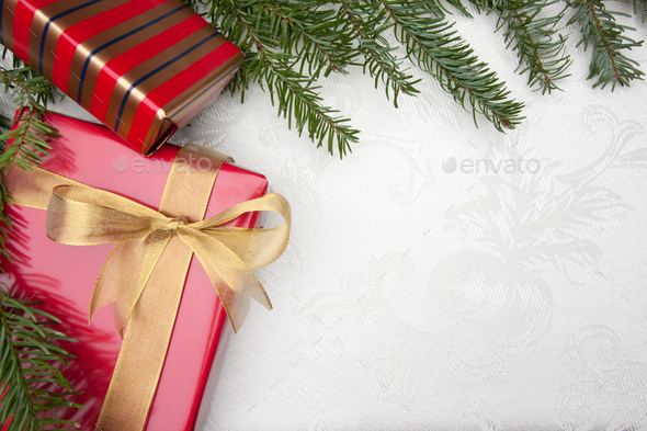 Silk Christmas Background with Gilfs and Pine Branches - Stock Photo - Images
