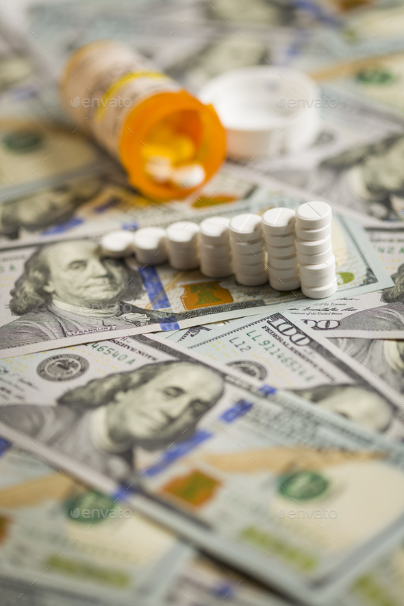 Medicine Pills Stacked on Newly Designed One Hundred Dollar Bills - Stock Photo - Images