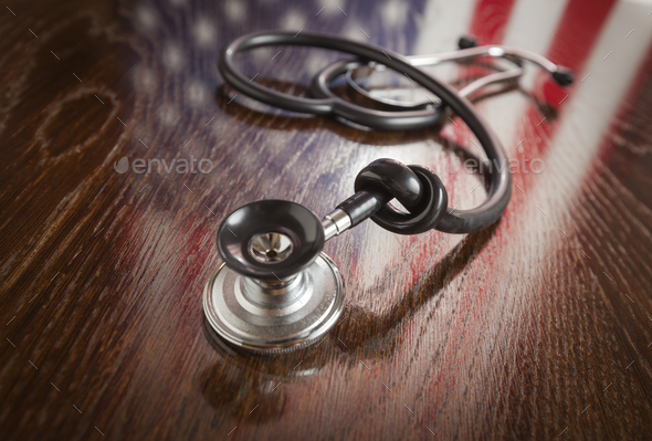 Knotted Stethoscope with American Flag Reflection on Table - Stock Photo - Images