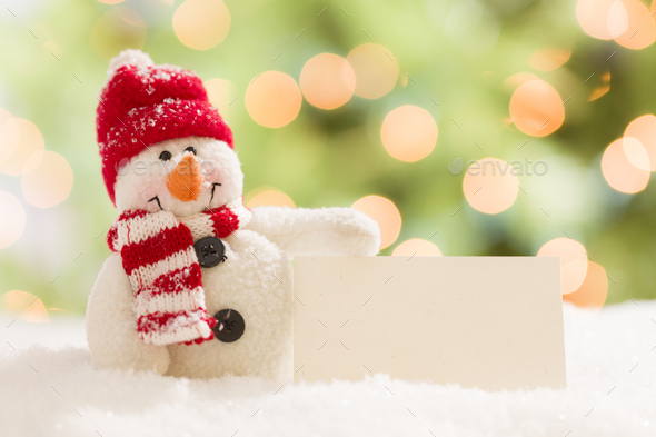 Cute Snowman with Blank White Card Over Abstract Background - Stock Photo - Images