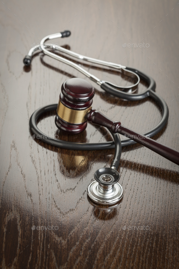Gavel and Stethoscope on Reflective Table - Stock Photo - Images