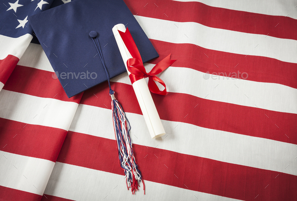 Graduation Cap and Diploma Resting on American Flag - Stock Photo - Images