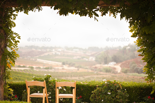 Vine Covered Patio and Chairs Overlooking the Country - Stock Photo - Images
