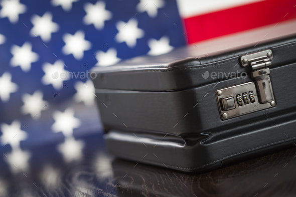 Leather Briefcase Resting on Table with American Flag Behind - Stock Photo - Images