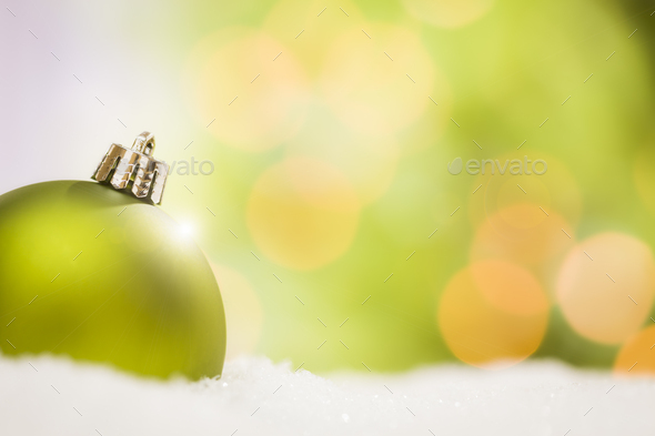 Green Christmas Ornaments on Snow Over an Abstract Background - Stock Photo - Images