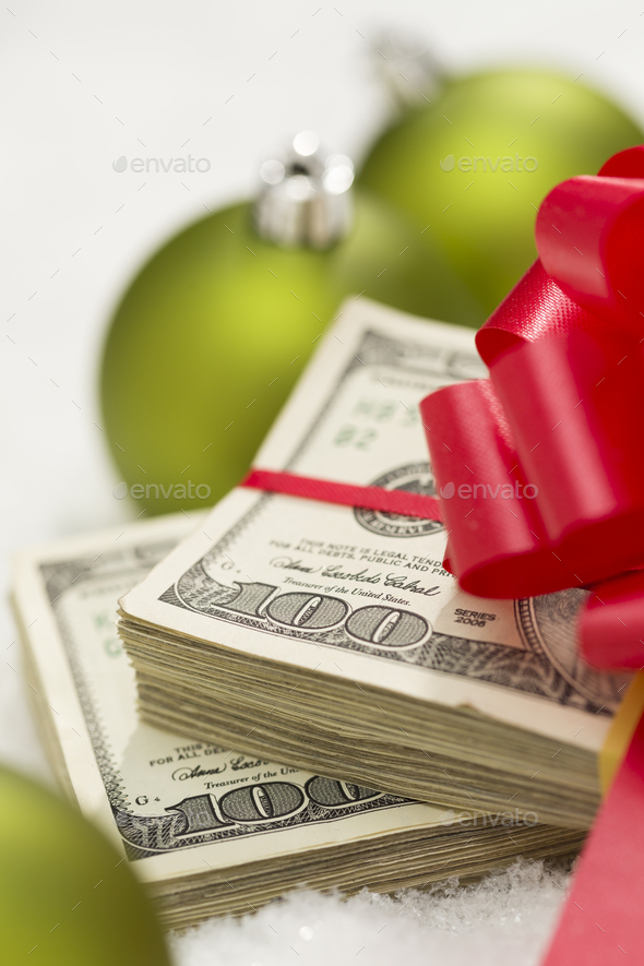 Stack of Hundred Dollar Bills with Bow Near Christmas Ornaments - Stock Photo - Images