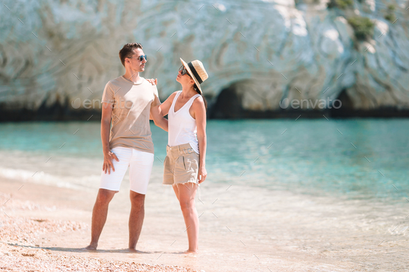 Young Family on white beach during summer vacation - Stock Photo - Images