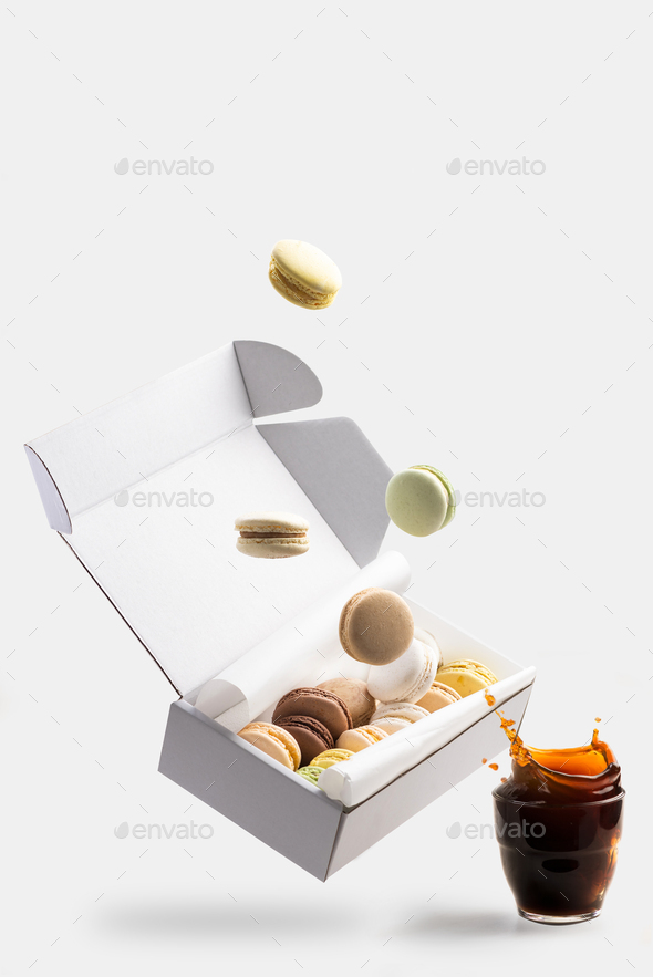 Macaroons Falling Down To Box. Flying Action Creative Food Photo - Stock Photo - Images