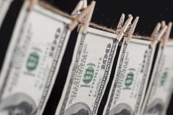 Hundred Dollar Bills Hanging From Clothesline on Dark Background - Stock Photo - Images