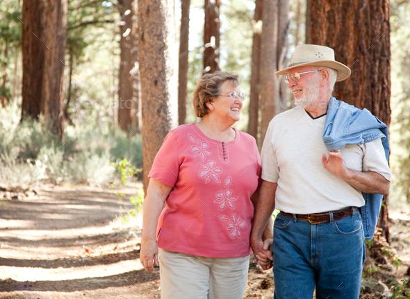 Loving Senior Couple Walking Together - Stock Photo - Images