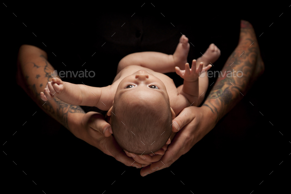 Hands of Father and Mother Hold Newborn Baby on Black - Stock Photo - Images