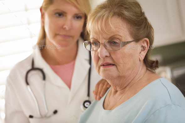 Senior Adult Woman Being Consoled by Female Doctor or Nurse - Stock Photo - Images