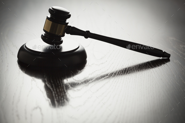 Dramatic Gavel Silhouette on Reflective Wood - Stock Photo - Images